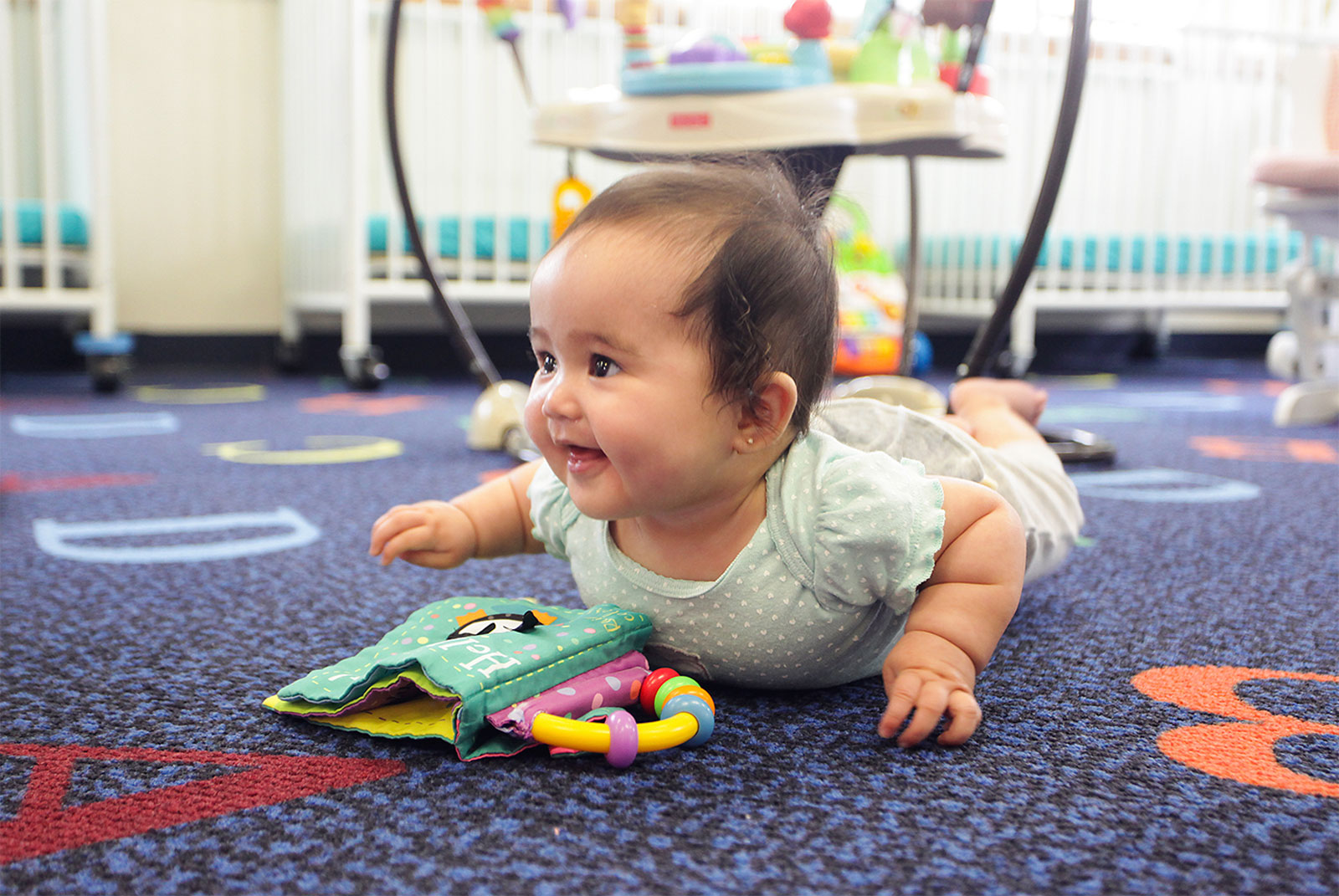 Child playing at Discovery Point Infant Daycare in the Almon Area