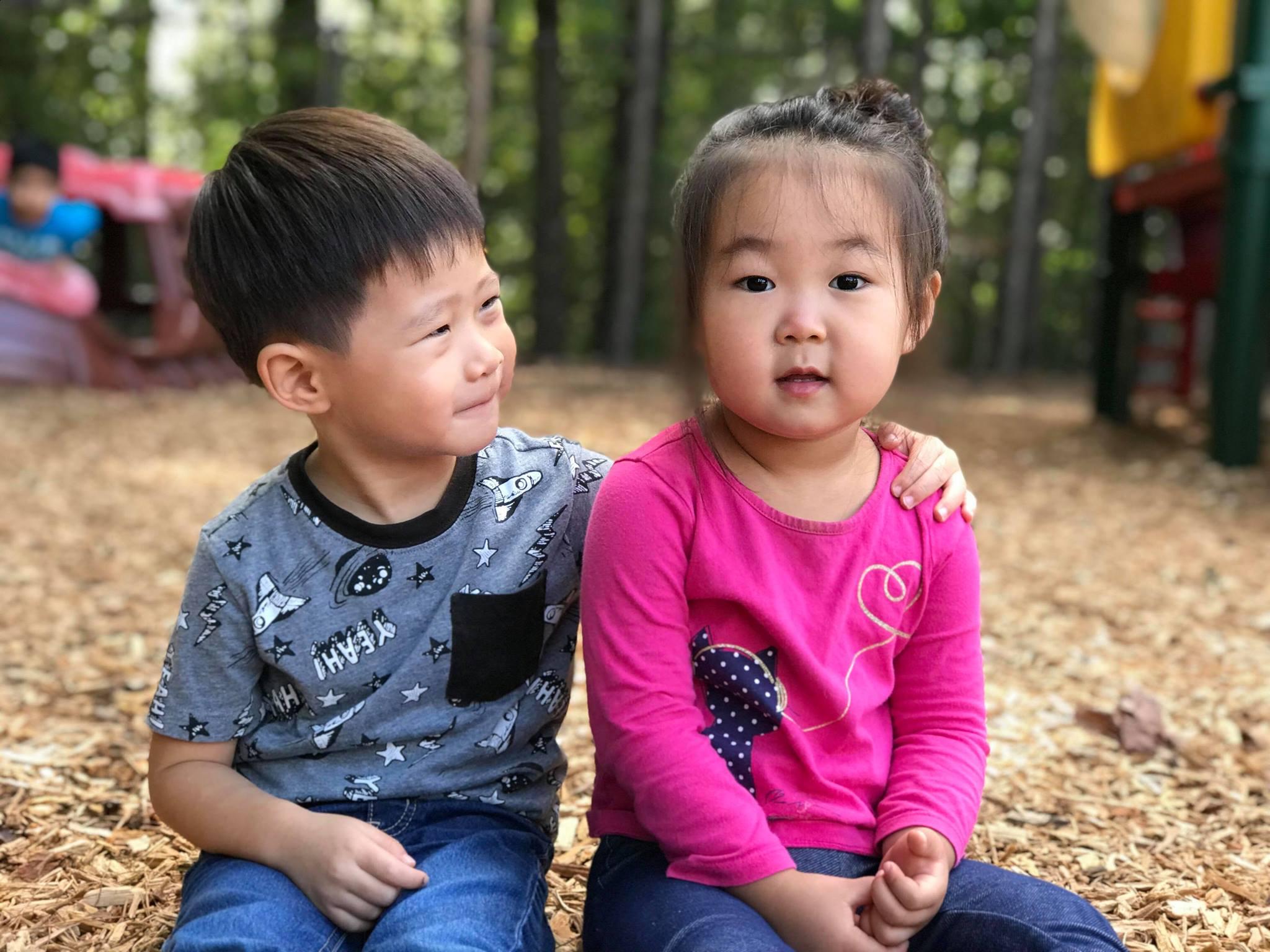 preschool girl and boy on playground