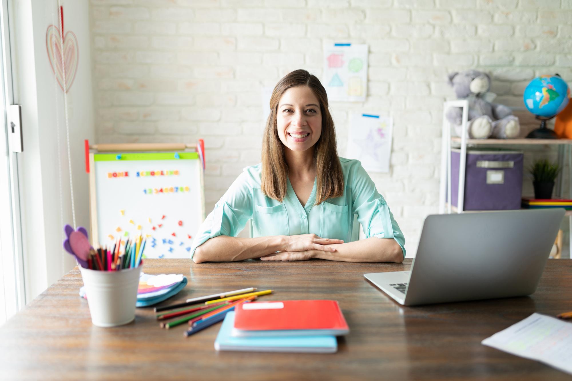 teacher sitting at desk