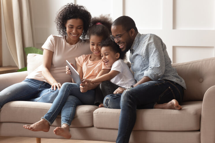 family reads book together